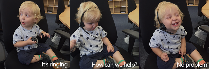 Pictures of small boy sitting on office chair with phone headset